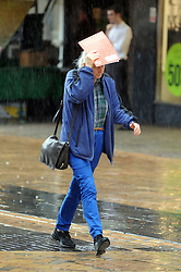 © Licensed to London News Pictures. 22/10/2013<br /> Heavy Rain today (22.10.2013) across the Greater London area.<br /> Shoppers in Bromley High Street,Bromley,Greater London get wet this afternoon.<br /> Photo credit :Grant Falvey/LNP