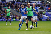 Mitch Pinnock of AFC Wimbledon under pressure from Marcus Maddison of Peterborough United during the EFL Sky Bet League 1 match between Peterborough United and AFC Wimbledon at London Road, Peterborough, England on 28 September 2019.