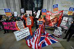 © Licensed to London News Pictures. 22/02/2020. LONDON, UK.  People in costumes and masks outside Australia House in Aldwych ahead of a march to Parliament Square in support of Wikileaks founder Julian Assange.  The full extradition trial of Mr Assange begins in London on 24 February.  Photo credit: Stephen Chung/LNP