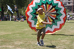 Stock photo of a boy running with a parachute