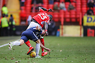 Charlton Athletic defender Mouhamadou-Naby Sarr (23) and Southend United midfielder Stephen McLaughlin (11) battle for the ball during the EFL Sky Bet League 1 match between Charlton Athletic and Southend United at The Valley, London, England on 9 February 2019.