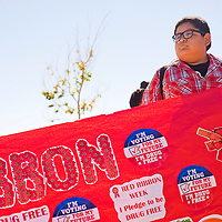 101612       Cable Hoover<br /> <br /> Tohatchi High School freshman Ryan Begay carries one end of parade banner during the Red Ribbon anti-drug parade in Tohatchi Tuesday.