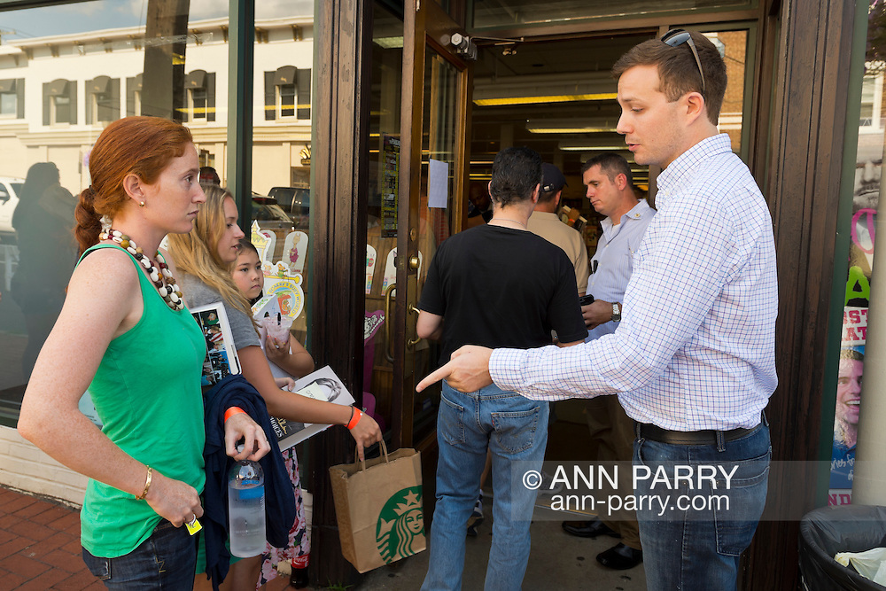 Huntington, New York, U.S. - August 6, 2014 - At the entrance to the Book Revue, a teen girl is told water bottles are not allowed at the book signing for H. Clinton's new memoir, Hard Choices, in Huntington, Long Island.