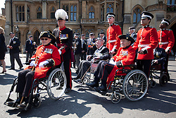 © Licensed to London News Pictures. 11/07/2013. London, UK. Chelsea Pensioners, all British veterans of the Korean War, are seen outside Westminster Abbey in London today (11/07/2013). The parade and service held to commemorate the 60th Anniversary of the end of the Korean War, often known as the 'Forgotten War', which saw a United Nations force of many nations fight against North Korean and Chinese forces trying to invade South Korea. Photo credit: Matt Cetti-Roberts/LNP