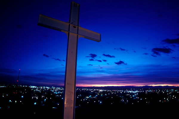 Close Up of Cross at Sunset in Elevated Part of City