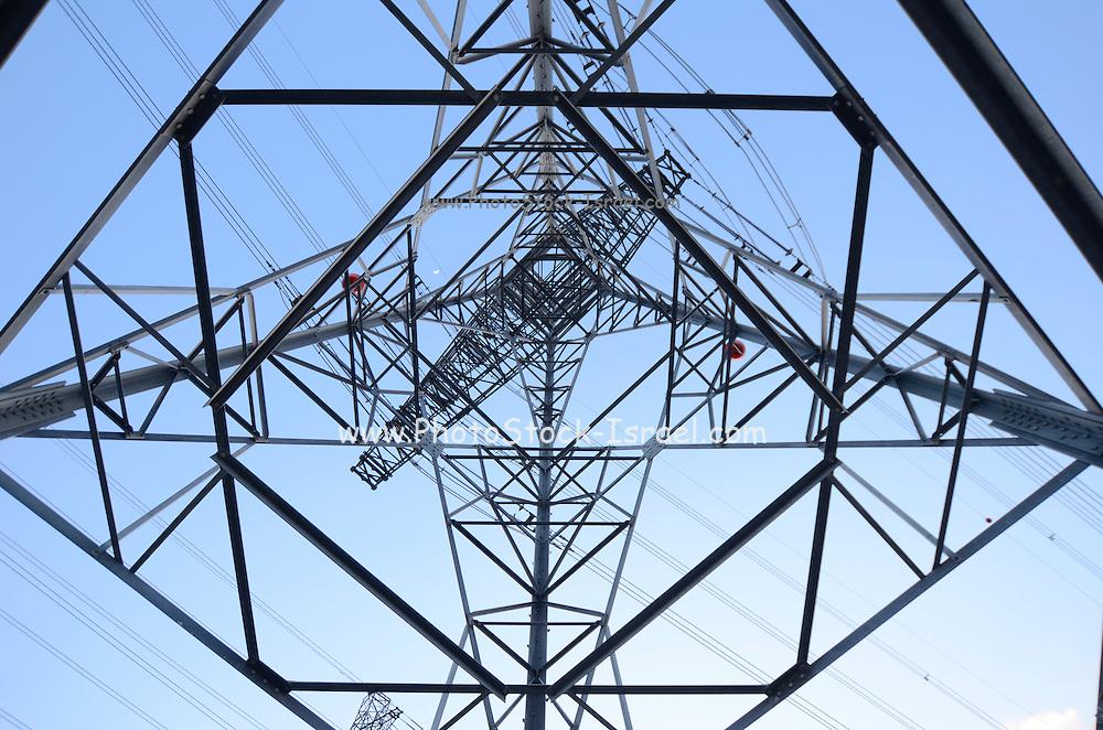 Power pylon on blue sky as seen from beneath