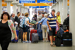© Licensed to London News Pictures. 12/08/2016. London, UK. Eurostar passengers  queue at St Pancras station in London as international rail passengers face a 4 day of travel chaos because of four separate Eurostar strikes in a dispute over members' work-life balance. Photo credit: Tolga Akmen/LNP