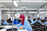 Rihem Agrebi works at a textile factory in Soliman, Tunisia. The factory produces clothes for Saks Fifth Avenue, Neiman Marcus, Benetton and Gant, among other clothing companies. The factory is considered off-shore and only exports, so it does not pay tax to Tunisia. Women work 48 hours each week and earn an average of $250 a month. Most left school early to earn money for their families.