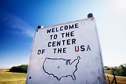 """Image of the """"Welcome to the Center of the USA"""" sign in Kansas, American Midwest by Randy Wells"""