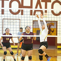 Aurelia Lowe sets the ball for Tohatchi in their volleyball match against Rehoboth Tuesday evening in Tohatchi. Rehoboth won the match in straight sets.
