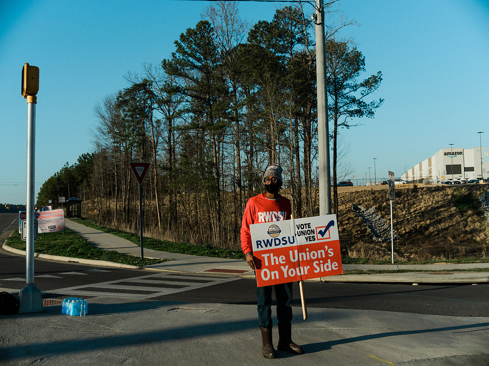 BESSEMER, AL – MARCH 10, 2021: Union member organizers from the Retail, Wholesale and Department Store Union rally support as workers change shifts outside of Amazon's BHM1 fulfillment center. If pro-union organizers are successful, the BHM1 fulfillment center in Bessemer will become the first unionized Amazon warehouse in the country. CREDIT: Bob Miller for HuffPost