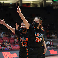 Gallup Bengals Cheyenne John (13) and Jordan Joe (34) signal to the referee that <br /> huddle before taking the court against the Espanola Valley Sundevils during the New Mexico Class 4A girls basketball championship game at The Pit in Albuquerque Saturday. The Bengals defeated the Sundevils 63-51 to become New Mexico Class 4A state champions.
