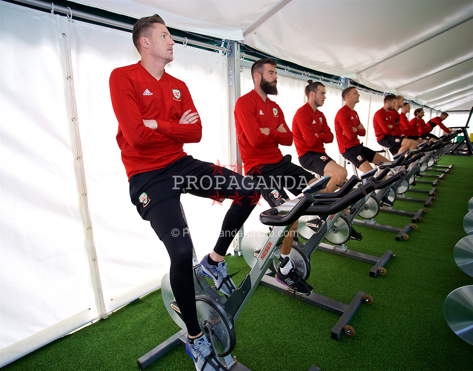 CARDIFF, WALES - Friday, September 7, 2018: Wales' goalkeeper Wayne Hennessey on a warm-up bike during a training session at the Vale Resort ahead of the UEFA Nations League Group Stage League B Group 4 match between Denmark and Wales. (Pic by David Rawcliffe/Propaganda)