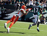 Cleveland Browns cornerback Joe Haden (23) leaps while trying to break up a pass play to Philadelphia Eagles wide receiver Nelson Agholor (17) who catches the 35 yard pass for a third quarter touchdown that gives the Eagles a 22-10 lead during the 2016 NFL week 1 regular season football game against the Cleveland Browns on Sunday, Sept. 11, 2016 in Philadelphia. The Eagles won the game 29-10. (©Paul Anthony Spinelli)