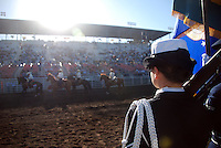 The color guard watches Friday night's Grand Entry at the 102nd California Rodeo Salinas, which opened July 19 for a four-day run.