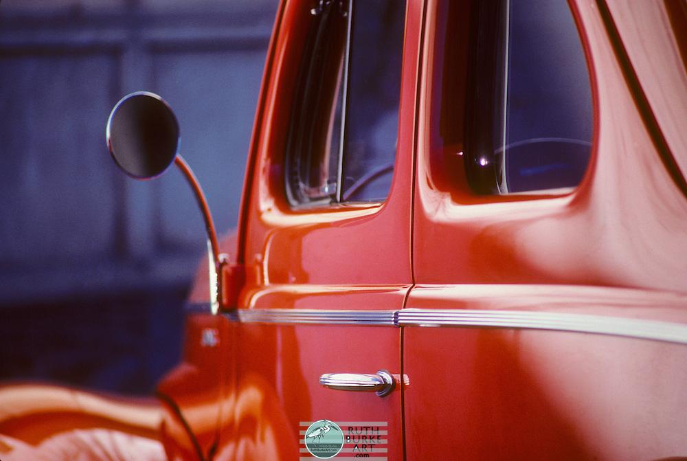 Antique Orange Car with rear view mirror