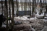 An informal camp not far from the town of Velika Kladusa. About 15 person from Bangladesh are living in a wood, they have placed some tents on a slippery icy slope not far from the official overcrowded camp called 'Moral' where more than a thousand are living. Velika Kladusa, January 29, 2021