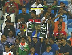 September 18, 2018 - Dubai, United Arab Emirates - Indian cricket fans hold a poster about Indian cricketer Virat Kohli during the 4th cricket match of Asia Cup 2018 between India and Hong Kong at Dubai International cricket stadium,Dubai, United Arab Emirates. 09-18-2018. (Credit Image: © Tharaka Basnayaka/NurPhoto/ZUMA Press)