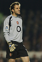 Photo: Javier Garcia/Back Page Images<br />Arsenal v Birmingham FA Barclays Premiership Highbury 04/12/04<br />Manuel Almunia, during an error-strewn debut, grimaces after slicing a clearance out