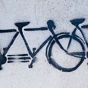 Bicycle graffiti art on a wall in downtown Buenos Aires Argentina.
