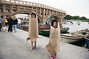 23/07/2018 Repro free:  Sean Clogherty Castlegar  and  Ruth Fergus from  Kingston 7 built there own carboard outfits at The People Build at Galway International Arts Festival saw not just one but two large-scale structures appear in a matter of hours built solely from cardboard. Under the guidance of French artist, Olivier Grossetete and his team, The People Build saw over 600 volunteers and members of the general public transform cardboard boxes into a church steeple and a bridge. This spectacular architectural event won the hearts of festival audiences and encouraged a sense of community where everyone could get involved. The structure built at Eyre Square was inspired by St. Nicholas' Church in Galway and the bridge at Waterside was positioned at the location of Galway's River Corrib Viaduct, once part of the famous Galway to Clifden Railway.<br /> <br /> It is estimated that almost 4 tonnes of cardboard were used across the two builds. Following the constructions, children and grown-ups alike joined forces in a massive celebratory demolition, which saw the cardboard structures come tumbling down amidst shrieks of joy and delight.<br /> <br /> Walsh Waste & Recycling have once again joined forces with Galway International Arts Festival to ensure there was no unnecessary waste following the event and were on hand to take away the crushed cardboard to be recycled. Photo:Andrew Downes, xposure