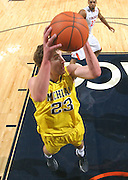 CHARLOTTESVILLE, VA- NOVEMBER 29: Evan Smotrycz #23 of the Michigan Wolverines grabs the rebound during the game on November 29, 2011 at the John Paul Jones Arena in Charlottesville, Virginia. Virginia defeated Michigan 70-58. (Photo by Andrew Shurtleff/Getty Images) *** Local Caption *** Evan Smotrycz