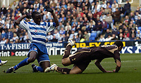 Photo: Jonathan Butler.<br /> Reading v Tottenham Hotspur. The Barclays Premiership. 12/11/2006.<br /> Ibrahima Sonko of Reading fouls Hossam Ghaly of Tottenham in the box and give away a penelty.