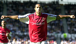 Arsenal's Thierry Henry celebrates after scoring from a free kick during the Barclaycard Premiership match at Pride Park, Derby. THIS PICTURE CAN ONLY BE USED WITHIN THE CONTEXT OF AN EDITORIAL FEATURE. NO WEBSITE/INTERNET USE UNLESS SITE IS REGISTERED WITH FOOTBALL ASSOCIATION PREMIER LEAGUE.