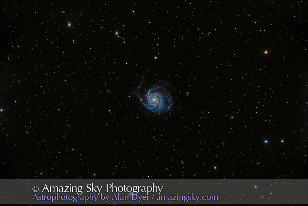 Messier 101, the Pinwheel Galaxy in Ursa Major, a classic face-on spiral galaxy, large and obvious in binoculars.  The odd galaxy at bottom is NGC 5474. <br /><br />This is a stack of 9 x 10-minute exposures with the Canon EOS Ra camera at ISO 800 through the Astro-Physics 130mm apo refractor at f/6 with the 6x7 field flattener lens.