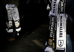 Match day scarves on sale outside the ground prior to the Premier League match at Wembley Stadium, London.