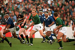 South Africa's captain Francois Pienaar shapes to pass the ball