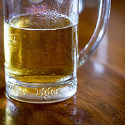 Closeup of big half empty glass of cold beer (Pnom Penh, Cambodia - Oct. 2008) (Image ID: 081031-1328421a)