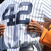Mariano Rivera, wearing number 42, is embraced by the hands of Rachel Robinson, widow of Jackie Robinson, during Mariano Rivera Day at Yankee Stadium.<br /> <br /> Image Copyright MLB Photos