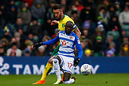 Norwich City defender Ivo Pinto (2) Reading striker Modou Barrow (17) battles for possession during the EFL Sky Bet Championship match between Norwich City and Reading at Carrow Road, Norwich, England on 17 March 2018. Picture by Phil Chaplin.