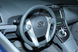 11 February 2009:  2009 TOYOTA PRIUS: With the redone 2010 Prius to be on display at the Chicago Auto Show, the unchanged '09 model is much like it has been. Rated the best-selling gas-electric hybrid vehicle in the United States and the world, Prius seats five passengers and can achieve 650 miles between fill-up. The Prius Hybrid Synergy Drive combines a 1.5-liter four-cylinder Atkinson Cycle gasoline engine and an electric drive motor. The gasoline engine uses variable valve timing, produces 76 horsepower, and when combined with the permanent-magnet electric drive motor, generates a total of 110 horses. All models come standard with an electronically controlled planetary gear-type continuously variable transmission. The upgraded Touring Edition offers European-inspired suspension and 16-inch alloy wheels, a larger rear spoiler, High Intensity Discharge (HID) headlamps and integrated fog lamps. Prius? liftback design, combined with the 60/40 split fold-down rear seatbacks, provides 14.4 cubic feet of cargo room.. The Chicago Auto Show is a charity event of the Chicago Automobile Trade Association (CATA) and is held annually at McCormick Place in Chicago Illinois.