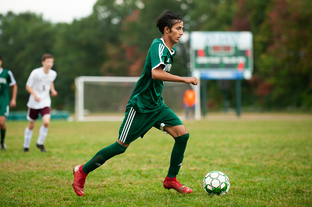 Winooski's Lek Nath Luitel (7) runs down the field with the ball during the boys soccer game between the Richard Eagles and the Winooski Spartans at Winooski High School on Saturday afternoon September 28, 2019 in Winooski, Vermont. (BRIAN JENKINS/for the FREE PRESS)