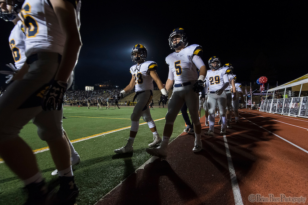 The Oak Ridge Trojans take the field after they warmed up before the game as the Del Oro Golden Eagles varsity football team host the Oak Ridge Trojans, Friday Oct 21, 2016.<br /> photo by Brian Baer