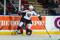 KELOWNA, CANADA - MARCH 16: Justin Sourdif #42 of the Vancouver Giants checks Kyle Topping #24 of the Kelowna Rockets on March 16, 2019 at Prospera Place in Kelowna, British Columbia, Canada.  (Photo by Marissa Baecker/Shoot the Breeze)