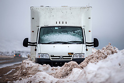 © Licensed to London News Pictures. 13/02/2020. Shap UK. An abandoned vehicle is encased in snow this morning on the A6 near Shap in Cumbria as the UK braces for more bad weather over the weekend. Photo credit: Andrew McCaren/LNP
