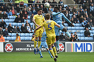 Bristol Rovers defender Daniel Leadbitter (2) heads the ball under pressure from Coventry City defender (on loan from Chelsea) Dujon Sterling (17) during the EFL Sky Bet League 1 match between Coventry City and Bristol Rovers at the Ricoh Arena, Coventry, England on 7 April 2019.