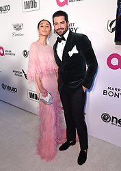 Cara Santana (left) and Jesse Metcalfe attending the Elton John AIDS Foundation Viewing Party held at West Hollywood Park, Los Angeles, California, USA.