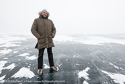 Dmitry Khitrov in the middle of Lake Baikal after the Baikal Mile Ice Speed Festival. Maksimiha, Siberia, Russia. Sunday, March 1, 2020. Photography ©2020 Michael Lichter.
