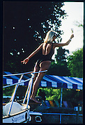 Henley, GREAT BRITAIN,   Girl raising a glass of Champagne, in a 'Titanic Pose' from the prow of a cruiser, Henley Royal Regatta, Henley Reach, 2-6 July 1997, Henley, ENGLAND [Mandatory Credit, Peter Spurrier/Intersport-images] Messing about on the River 1997 Henley Royal Regatta, Henley, Great Britain