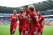 Anthony Pilkington of Cardiff city © celebrates with teammates  after he scores his sides 2nd goal. Skybet football league championship match, Cardiff city v Sheffield Wed at the Cardiff city stadium in Cardiff, South Wales on Saturday 27th Sept 2014<br /> pic by Andrew Orchard, Andrew Orchard sports photography.