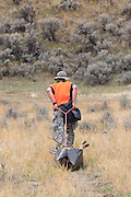 Using a game sled, successful backcountry hunter Josh Falkos drags a nice mule deer buck out of the hills east of Dillon, Montana.