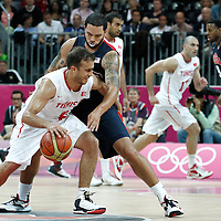 31 July 2012: USA Deron Williams defends on Tunisia Marouan Kechrid during 110-63 Team USA victory over Team Tunisia, during the men's basketball preliminary, at the Basketball Arena, in London, Great Britain.