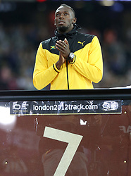 Jamaica's Usain Bolt is presented with a part of the London 2012 track before doing a lap of honour during day ten of the 2017 IAAF World Championships at the London Stadium. PRESS ASSOCIATION Photo. Picture date: Sunday August 13, 2017. See PA story ATHLETICS World. Photo credit should read: Martin Rickett/PA Wire. RESTRICTIONS: Editorial use only. No transmission of sound or moving images and no video simulation.