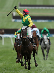 Jockey Robbie Power celebrates after his winning ride on Sizing John in the Timico Cheltenham Gold Cup Chase during Gold Cup Day of the 2017 Cheltenham Festival at Cheltenham Racecourse.