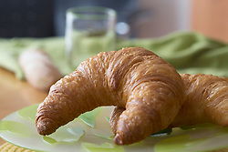 Close-up of croissants served on plate, Freiburg im Breisgau, Baden-Wuerttemberg, Germany