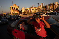 © Licensed to London News Pictures. 16/08/2020. Beirut, Lebanon. Two children look at the blast site in Beirut Port following the huge explosion on 4 August. Photo credit : Tom Nicholson/LNP